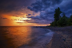 approaching storm at sunset, lake superior (twurdemann) Tags: 09ndsoftgrad beach canada cottrellcove fujixt1 gnd3s highway17 horizon hoyandx8 lakesuperior landscape leeseven5 longexposure nature neutraldensityfilter northernontario ontario rain sawpitbay scenic seascape shoreline sky stonebeach storm summer sunset thunderstorm water weather xf14mm