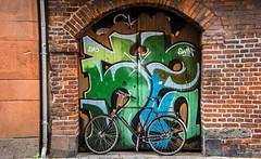 2016 - Baltic Cruise - Copenhagen - Arch Work (Ted's photos - For Me & You) Tags: 2016 balticcruise tedmcgrath tedsphotos copenhagen cropped vignetting bicycle denmark bricks arch colorful colourful