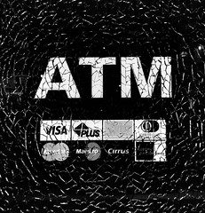 Cracks in the Economy (Tyler Merbler) Tags: glass shatter americanexpress cirrus maestro mastercard visa federalreserve currency finance money dollar usa atm cronycapitalism