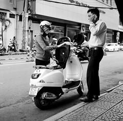 Paying for the ride (mteckes) Tags: hasselblad 500c bw kodak kodaktrix trix ziessplanar80mm28 zeiss saigon hochiminhcity vietnam film blackandwhite monochrome