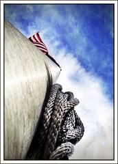 Flag pole (Bob R.L. Evans) Tags: halyard usflag sky clouds perspective metal ipadphotography