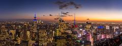 Top of the Rock - New York City (hjuengst) Tags: skylinenewyork newyork rockefellercenter empirestatebuilding sunset panorama streetlight topoftherock