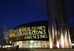 Cardiff Millenium Centre (Raphooey) Tags: lighting christmas uk light sky colour tree water wales night canon stars eos lights star bay stream dusk steel south centre cardiff millenium nightime gb column coloured streaming stainless 70d eveningh
