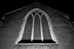 All Saint's in the Darkness (B/W) (DaveJC90) Tags: camera old winter light shadow blackandwhite bw white black detail building tree slr classic church window rock stone night digital dark lens evening early suffolk nikon village darkness angle bright path wide wideangle sharp crop late 1855mm 1020mm footpath pathway croped sharpness bealings littlebealings d5100