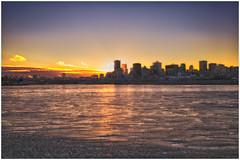 Sunset, Montreal (SergeK ) Tags: city sunset sun canada ice water river soleil eau quebec montreal explore stlaurent ml ville coucherdesoleil glace saintlawrence sergek