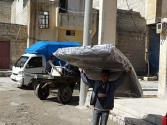 Carrying a mattress home in Aleppo (Ummah Welfare Trust) Tags: poverty winter children war refugee islam arabic east relief hunger arab middle shaam humanitarian aleppo displaced humanitarianism ummah idlib