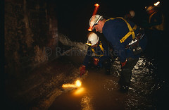 brief title (christophersheard1947) Tags: old city uk greatbritain england people male men brick london english industry water wall work underground clothing team europe employment britain inspection group under pipes victorian eu historic safety torch staff health crew workplace flashlight worker british network flowing waste tunnels fleet monitoring subterranean filthy sewer job beneath shining overhead nineties 1990s waders 90s employee wading pipework foul cityoflondon teamwork career healthandsafety conditions dated inspecting polluted unpleasant effluent workforce claustraphobia