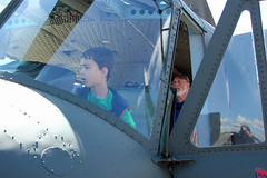 Grandson Is My Copilot (planephotoman) Tags: bell uh1 uh1h 6916733 7016386 grandson copilot checkingoutthehelo knightsoftheair 114 vietnamhelicopterpilotsassociation washingtonstatechapter olympicflightmuseum olympicairshow 2016olympicairshow fathersdayairshow olympiawa olympiaregionalairport olm kolm