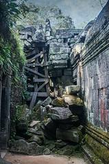Tidying Up (gecko47) Tags: history texture archaeology architecture ruins cambodia stones timber angkorwat taprohm rubble bracing buildingblocks 12thcentury jerryjones khmerculture monasteryanduniversity