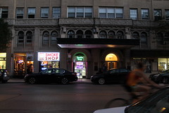 Saturday Evening (Flint Foto Factory) Tags: chicago illinois urban city summer 2016 nortt late september north edgewater granville kenmore intersection smoke shop store front reflection bicycle rider bicylist