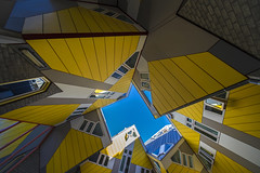 among cubes (Blende1.8) Tags: kubushuser rotterdam cubehouses cube cubes geometry geometrie colours farben gelb yellow blue sky blau voigtlnder 10mm sony alpha ilce7m2 a7ii a7m2 carstenheyer netherlands architecture architektur wideangle urban building gebude modern contemporary