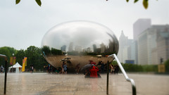 Shelter in Red (brent flanders) Tags: millenniumpark chicago il cloudgate rain architecture d7000 nikond7000 nikon nikon1024mmf3545gedafsdxnikkorwideanglezoomlens illinois skyscraper skyscrapers chicagoskyscrapers chicagocloud gated7000nikon d7000nikonnikon 1024mm f3545g ed afs dx nikkor wideangle zoom lensillinoisskyscraperskyscraperschicago skyscraperschicagooutdoorskylinearchitecturebuilding