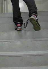 Shackled prisoner in NB574 taking mug shot (asiancuffs) Tags: handcuffs shackles shackled handcuffed arrest arrested inmate prisoner