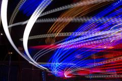Orbiter Ride (josullivan.59) Tags: wallpaper 3exp red texture ontario outside artisitic abstract autumn detail fall lightanddark london londonont canon6d canada canonef24105mmf4lisusm blue blur night minimalism magenta ride midway fair black september 2016