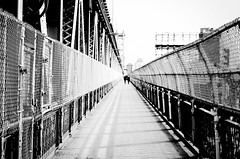 Vanishing Point (taborchichakly) Tags: road old city nyc newyorkcity bridge people urban blackandwhite bw usa newyork cold texture monochrome lines silhouette fence walking outside photography vanishingpoint cool afternoon general time action outdoor path manhattan metallic room shapes streetphotography overpass style peaceful pedestrian monotone location structure symmetry depthoffield chainlink sidewalk american walkway manhattanbridge manmade northamerica symmetrical features concept setting effect continent isolated pathway treatment urbanphotography timeofday architecturephotography typeofphotography