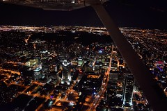 Downtown Montreal (olivier.demarcin) Tags: from city light sky streets window by skyline night plane dark airplane lights fly flying wings nikon cityscape view montreal aircraft over aerial cessna 152 c152
