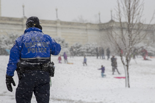 US Capitol Police and sledders