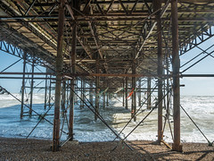 Under the Deck (Rupert Brun) Tags: ocean sea beach bag sussex pier spring warm brighton wind may windy sunny rope plastic pollution string environment bags breeze