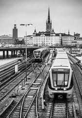 SL pendeln (Gabriel Berg) Tags: city white black tower church train hall cityscape sweden stockholm rail sl tre kronor pendeln