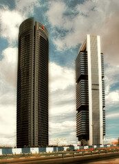 Towers (AlberBarrera) Tags: madrid two sky black clouds cloudy metallic towers dramatic icon iconic pwc