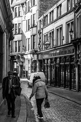 Strangers in close proximity (Johnbasil1) Tags: street bw contrast newcastle walking strangers