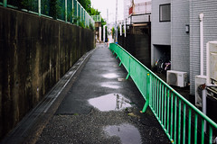 Puddle (yasu19_67) Tags: morning green rain japan zeiss puddle alley atmosphere osaka raincloud digitaleffects photooftheday filmlook filmlike vsco vscofilm sel35f28z sonnartfe35mmf28za sony7ilce7