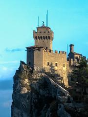 IMG_2895-Editx5 (kseniabramley) Tags: italy 2008 europe sanmarino castle stone medieval tower watchtower cliff rocks trees bushes sky