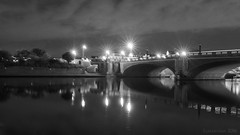 an old bridge still strutting its stuff (lunaryuna) Tags: england hamptoncourt hamptoncourtbridge riverthames night nightlights nightphotography nocturnalphotography seeingdouble reflection liquidmirrorworlds illumination streetlanterns beauty architecture historicarchitecture light lightmood le longexposure lunaryuna blackmwhite bw monochrome