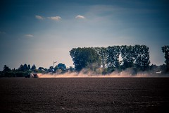 Farming the land... (Hiking-Dennis) Tags: soil field evening dust dawn sunset landscape agriculture corn earth clouds working farming