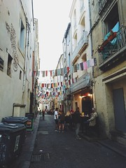 Ctre Historique (Lucas Marcomini) Tags: travel streetphotography wanderlust lucasmarcomini architecture wander street alley buildings colors city life old town ontheroad outthere letsexplore lonelyplanet beautifuldestinations montpellier visitmontpellier tourism trip traveling mediterranean airbnb vacations backpack backpacking france explore exploring exploration atmosphere bohemiam boho indie folk liveauthentic flowers flags