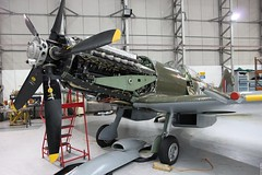 Spitfire FR Mk. XIV MV293 showing its big RR Griffon engine, Duxford UK (Jeroen.B) Tags: show uk flying flickr air engine rr rollsroyce maintenance legends duxford spitfire fr hanger mk warbird 65 xiv airfield griffon 2014 jej egsu mv293 flyinglegends2014
