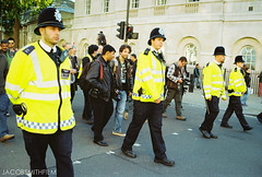The Line (JacobSmithFilm) Tags: street uk light summer england sun colour london film westminster contrast 35mm march high nikon fuji cops bright military jacob protest police smith line fujifilm downing f401 fujicolour jacobsmithfilm