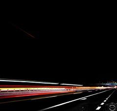 Prova di scie (JackTorva) Tags: road street blue light red italy panorama white black nature yellow night canon landscape eos rebel reflex italia blu ngc trails natura giallo contrails rosso bianco nero ef notte luce paesaggio lazio buio esposizione autostrada fari 70210mm scie xti 400d sciee
