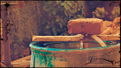 Need. (Syed Hamza Hassan) Tags: life wood old pakistan tree brick water leaves yellow canon effects photography back store flickr drum traditional tube lawn funky best storage explore need ripples past hue throw roofing multan photooftheday necessity regulation methods archieve