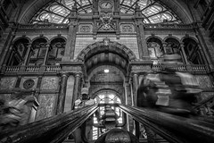 Antwerpen Central Station (PaulHoo) Tags: people bw detail monochrome station architecture stairs movement nikon belgium candid central streetphotography nik vignette hdr antwerpen lightroom 2015 colorefex d700