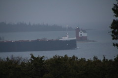 American Century (American Steamship) Passing Mackinac Island (May 4, 2016) (cseeman) Tags: morning lake water fog island lighthouses michigan ships foggy greatlakes beacons 1000 mackinacisland lakehuron freighter mackinac straitsofmackinac americancentury lakefreighter roundislandlighthouse roundislandpassagelight selfunloader roundislandlight lighthousesofmichigan americansteamship thousandfooter lighthousesoflakehuron smallrurallibraries2016 freighteramericancentury thousandfootfreighter