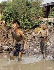 Boys playing in mud (Never.Stop.Searching!) Tags: boys mud laos indochina kids river play