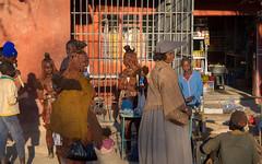 Opuwo street scene (loveexploring) Tags: africa herero himba himbahairstyle kuneneregion namibia opuwo victoriandress candid market people plaits shop street streetphotography streetscene