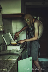Cooking 101 With Wheeza (micahmoreland) Tags: creepy horror surreal surrealism surrealist conceptual costume wheezer world war 2 ii dystopian scary haunting wet plate grunge texture male toxic death danger gas mask thin skinny abandoned house urbex urban exploration kitchen disturbing comical