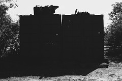 (jean_pichot1) Tags: white sidebyside pair massive bw day trees large nobody silhouette container shipyard industrial shadow backlit shape bright two center mass black number box metal dark heavy