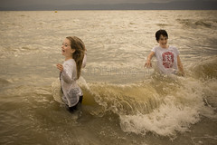 In the Sea (ArdieBeaPhotography) Tags: ocean girls sea playing beach smiling sisters swimming laughing hair happy coast jumping surf waves gulf pacific horizon overcast clothes jeans shirts together leaping firth hauraki tikapa