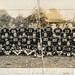 Damaged group photo of a school football team