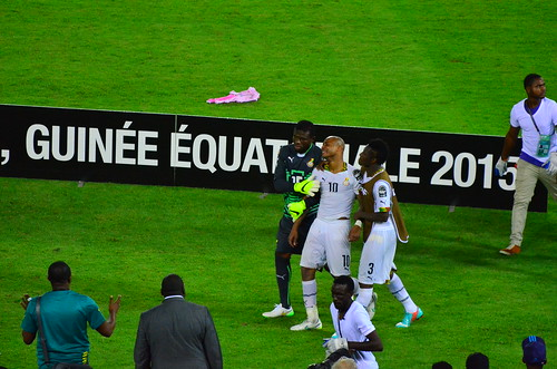 The face of agony: Andre Ayew of Ghana being held up by Brimah Razak and Asamoah Gyan