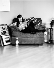 Natsumi (christait) Tags: portrait blackandwhite bw woman canada calgary laughing sitting drinking whiskey livingroom chilling ilfordhp5 alberta graflex yyc crowngraphic natsumi sheimpflug schneider210mmf56symmars rodinal1100stand2hrs