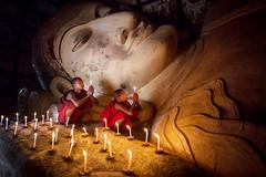 Devotion (paulpaulpauly) Tags: canon worship burma monk myanmar candlelight usm f28 6d novice ef20mm shinbinthalyaungtemple largerecliningbuddha