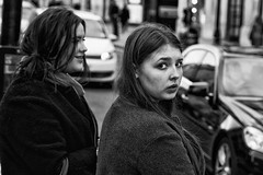 IMG_1709-Edit (roger_thelwell) Tags: life street city uk winter portrait england people urban bw white black streets cold london lamp monochrome westminster beauty hat rain leather mobile umbrella hair bag walking real photography mono chat shiny phone traffic post natural photos britain circus cigarette candid cab taxi great over sac hats cell photographic smoking lamppost photographs oxford conversation shiney talking shoulder handbag stud speak speaking studs commuters scak