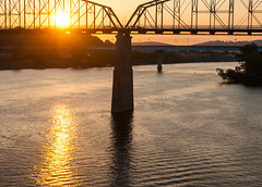 Sunrise on the Tennessee River (rpennington9) Tags: sunrise sunrises bridges reflection reflections lensflare tennessee chattanooga nikon nikond90 tennesseeriver walnutstreetbridge rivers river