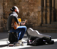 Street musician (chrisk8800) Tags: guitar oldquarter light shadow street barcelona busker