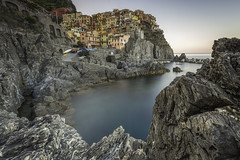Embraced (Pureo) Tags: cinqueterre seascape rocks dawn le longexposure houses colourful italy canon canon6d