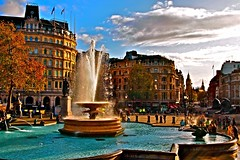 Trafalgar Square...rehashed (MickyFlick) Tags: trafalgarsquare london england housesofparliament bigben pigeons people autumncolours fountain lions statues iconiclandmark